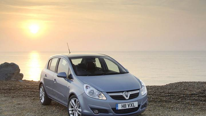 Vauxhall Corsa In Blue Near Sea At Sunset Time